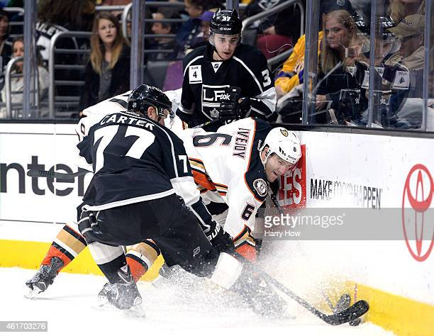 Ben Lovejoy of the Anaheim Ducks attempts to clear the puck as Nick Shore and Jeff Carter of the Los Angeles Kings follow the puck during the second...