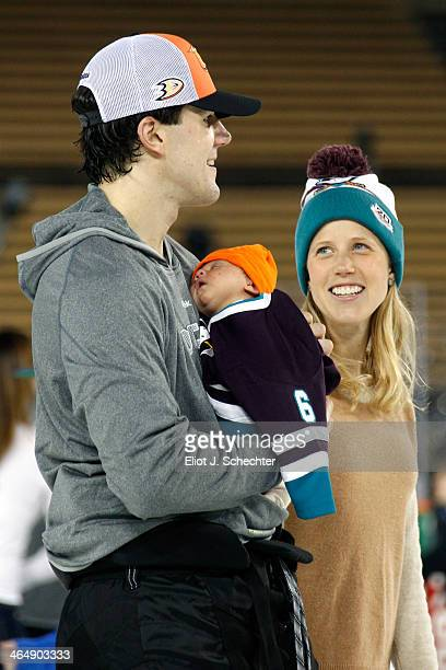Ben Lovejoy of the Anaheim Ducks holds his newborn daughter Lila and skates with his wife Avery during the family skate following team practice for...