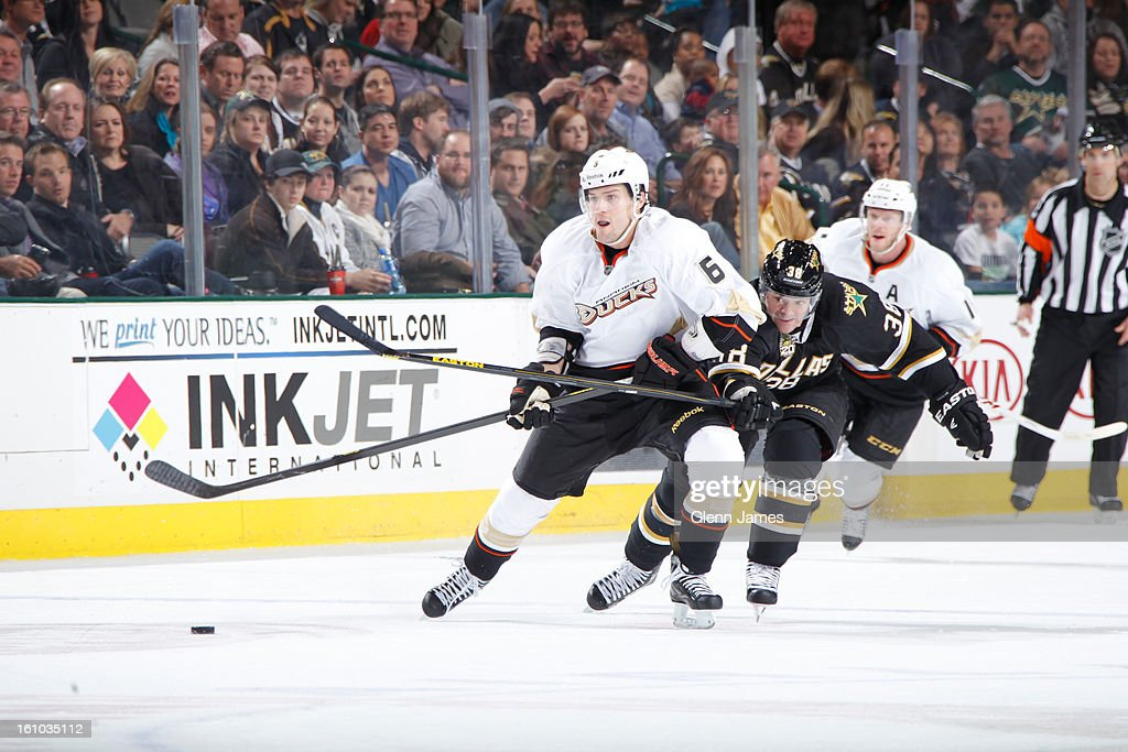 <a gi-track='captionPersonalityLinkClicked' href=/galleries/search?phrase=Ben+Lovejoy&family=editorial&specificpeople=4509565 ng-click='$event.stopPropagation()'>Ben Lovejoy</a> #6 of the Anaheim Ducks tries to keep the puck away against <a gi-track='captionPersonalityLinkClicked' href=/galleries/search?phrase=Vernon+Fiddler&family=editorial&specificpeople=208086 ng-click='$event.stopPropagation()'>Vernon Fiddler</a> #38 of the Dallas Stars at the American Airlines Center on February 8, 2013 in Dallas, Texas.