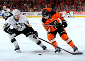 Ben Lovejoy of the Pittsburgh Penguins and Matt Read of the Philadelphia Flyers fight for the puck in the second period on April 5 2015 at the Wells...