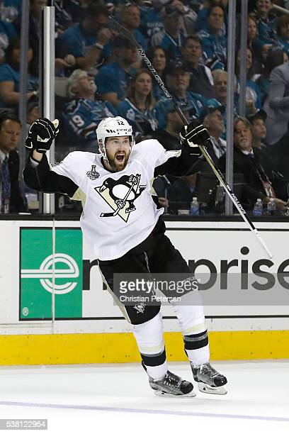 Ben Lovejoy of the Pittsburgh Penguins celebrates his assist to Patric Hornqvist to score a goal during the second period against Martin Jones of the...