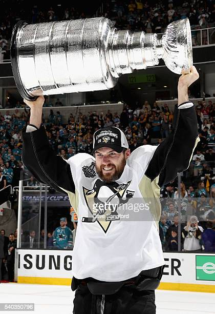 Ben Lovejoy of the Pittsburgh Penguins celebrates with the Stanley Cup after the Penguins won Game 6 of the 2016 NHL Stanley Cup Final over the San...