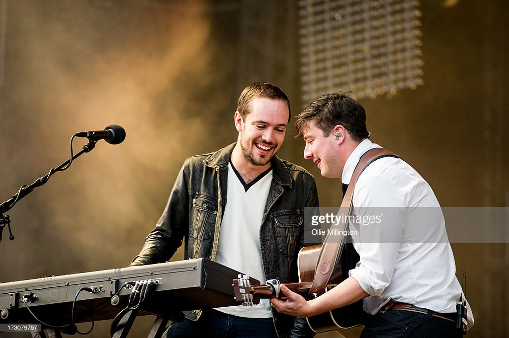 <a gi-track='captionPersonalityLinkClicked' href=/galleries/search?phrase=Ben+Lovett&family=editorial&specificpeople=3039181 ng-click='$event.stopPropagation()'>Ben Lovett</a> and <a gi-track='captionPersonalityLinkClicked' href=/galleries/search?phrase=Marcus+Mumford&family=editorial&specificpeople=5385533 ng-click='$event.stopPropagation()'>Marcus Mumford</a> of Mumford & Sons perform at their biggest headline show to date during the Summer Stampede tour at Olympic Park on July 6, 2013 in London, England.