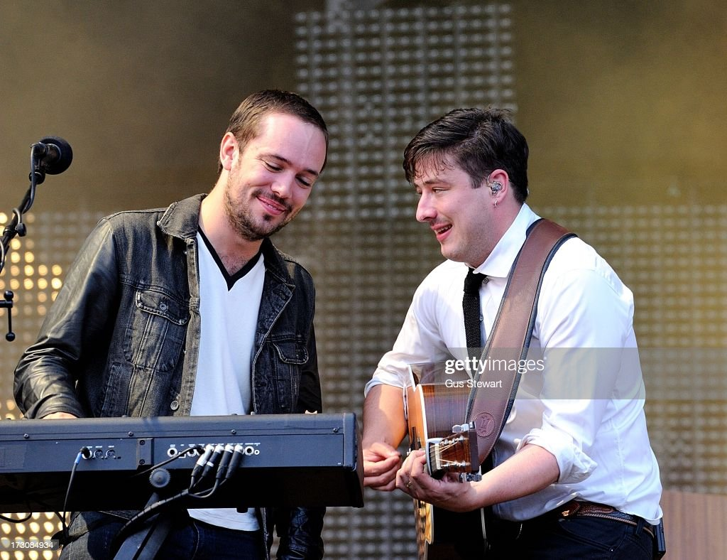 <a gi-track='captionPersonalityLinkClicked' href=/galleries/search?phrase=Ben+Lovett&family=editorial&specificpeople=3039181 ng-click='$event.stopPropagation()'>Ben Lovett</a> and <a gi-track='captionPersonalityLinkClicked' href=/galleries/search?phrase=Marcus+Mumford&family=editorial&specificpeople=5385533 ng-click='$event.stopPropagation()'>Marcus Mumford</a> of Mumford & Sons performs on stage at The Summer Stampede at Queen Elizabeth Olympic Park on July 6, 2013 in London, England.