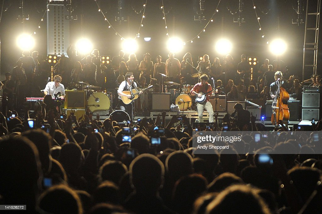 Ben Lovett Marcus Mumford Winston Marshall and Ted Dwane of Mumford Sons perform on stage at LBJ Lawn University of Texas presented by Myspace on...