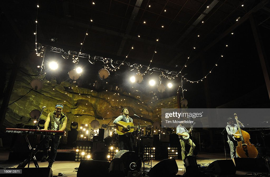Ben Lovett Marcus Mumford Winston Marshall and Ted Dwane of Mumford Sons perform in advance of the bands' Babel release at Red Rocks Amphitheatre on...