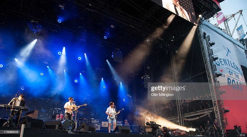 <a gi-track='captionPersonalityLinkClicked' href=/galleries/search?phrase=Ben+Lovett&family=editorial&specificpeople=3039181 ng-click='$event.stopPropagation()'>Ben Lovett</a>, <a gi-track='captionPersonalityLinkClicked' href=/galleries/search?phrase=Marcus+Mumford&family=editorial&specificpeople=5385533 ng-click='$event.stopPropagation()'>Marcus Mumford</a>, <a gi-track='captionPersonalityLinkClicked' href=/galleries/search?phrase=Winston+Marshall&family=editorial&specificpeople=3124664 ng-click='$event.stopPropagation()'>Winston Marshall</a> and <a gi-track='captionPersonalityLinkClicked' href=/galleries/search?phrase=Ted+Dwane&family=editorial&specificpeople=5856816 ng-click='$event.stopPropagation()'>Ted Dwane</a> of Mumford & Sons perform at their biggest headline show to date during the Summer Stampede tour at Olympic Park on July 6, 2013 in London, England.