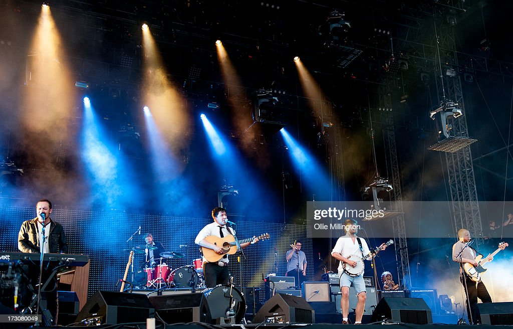 Ben Lovett, Marcus Mumford, Winston Marshall and Ted Dwane of Mumford & Sons perform at their biggest headline show to date during the Summer Stampede tour at Olympic Park on July 6, 2013 in London, England.