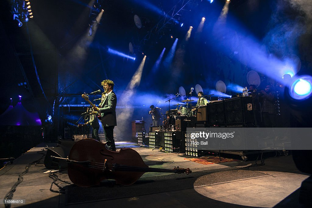 <a gi-track='captionPersonalityLinkClicked' href=/galleries/search?phrase=Ben+Lovett&family=editorial&specificpeople=3039181 ng-click='$event.stopPropagation()'>Ben Lovett</a>, <a gi-track='captionPersonalityLinkClicked' href=/galleries/search?phrase=Marcus+Mumford&family=editorial&specificpeople=5385533 ng-click='$event.stopPropagation()'>Marcus Mumford</a>, <a gi-track='captionPersonalityLinkClicked' href=/galleries/search?phrase=Winston+Marshall&family=editorial&specificpeople=3124664 ng-click='$event.stopPropagation()'>Winston Marshall</a> and <a gi-track='captionPersonalityLinkClicked' href=/galleries/search?phrase=Ted+Dwane&family=editorial&specificpeople=5856816 ng-click='$event.stopPropagation()'>Ted Dwane</a> perform with Mumford and Sons at RockNess festival at Village Of Dores on June 8, 2012 in Inverness, Scotland.