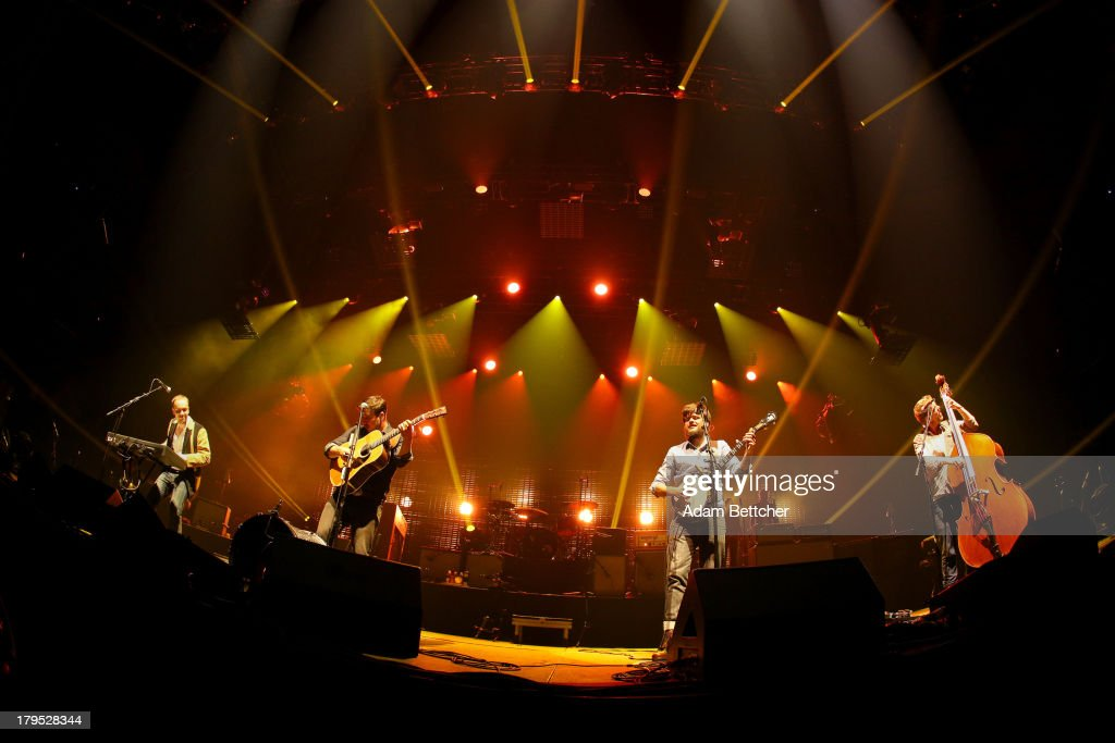 <a gi-track='captionPersonalityLinkClicked' href=/galleries/search?phrase=Ben+Lovett&family=editorial&specificpeople=3039181 ng-click='$event.stopPropagation()'>Ben Lovett</a>, <a gi-track='captionPersonalityLinkClicked' href=/galleries/search?phrase=Marcus+Mumford&family=editorial&specificpeople=5385533 ng-click='$event.stopPropagation()'>Marcus Mumford</a>, <a gi-track='captionPersonalityLinkClicked' href=/galleries/search?phrase=Winston+Marshall&family=editorial&specificpeople=3124664 ng-click='$event.stopPropagation()'>Winston Marshall</a> and Ted Dwayne of the band Mumford & Sons perform on September 4, 2013 at The Xcel Energy Center in St. Paul, Minnesota.