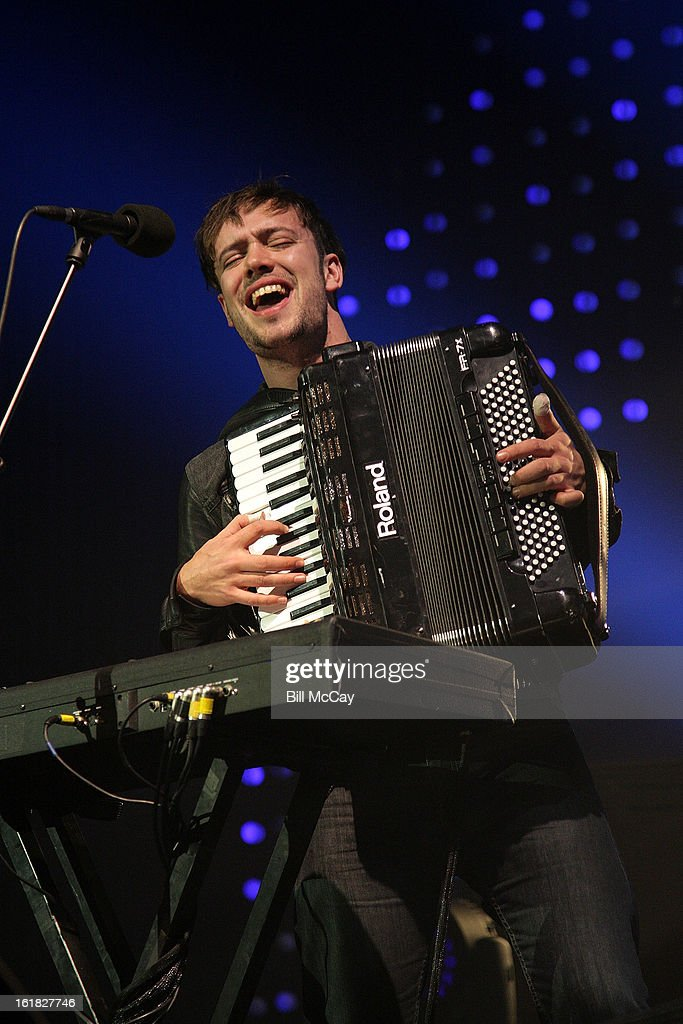 <a gi-track='captionPersonalityLinkClicked' href=/galleries/search?phrase=Ben+Lovett&family=editorial&specificpeople=3039181 ng-click='$event.stopPropagation()'>Ben Lovett</a> of Mumford And Sons performs at the Susquehanna Bank Center February 16, 2013 in Camden, New Jersey.