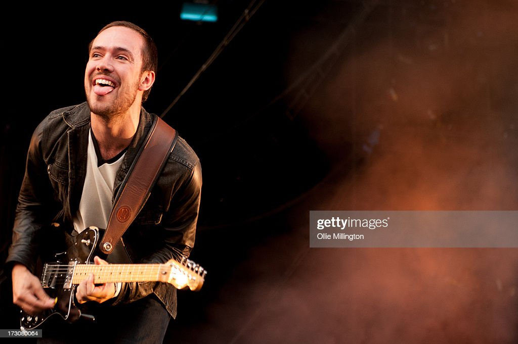 Ben Lovett of Mumford & Sons performs at their biggest headline show to date during the Summer Stampede tour at Olympic Park on July 6, 2013 in London, England.