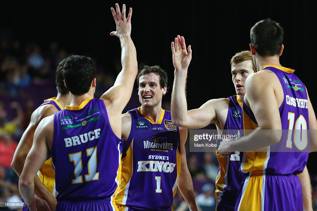 Ben Madgen of the Kings celebrates with his team mates after a basket during the round 21 NBL match between the Sydney Kings and the Townsville Crocodiles at Sydney Entertainment Centre on March 3, 2013 in Sydney, Australia.