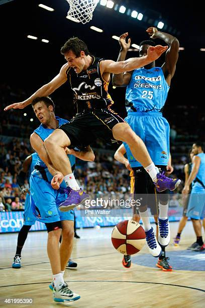 Ben Madgen of the Kings crashes into Tom Abercrombie of the Breakers during the round 16 NBL match between the New Zealand Breakers and the Sydney...