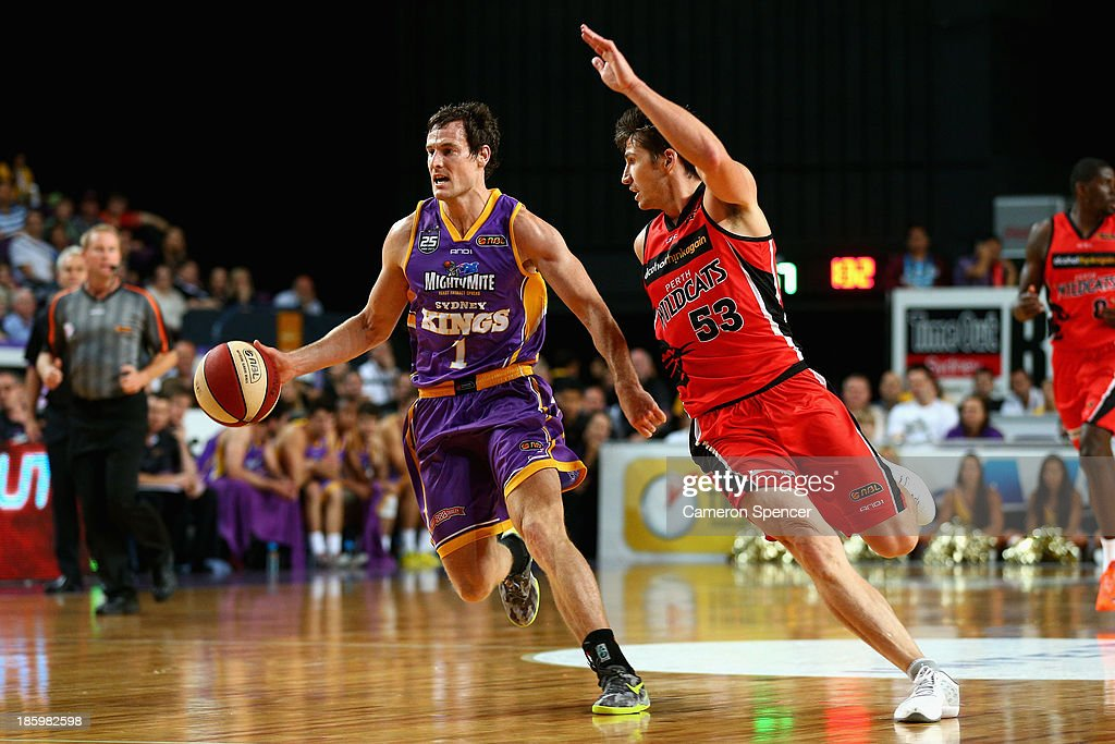 Ben Madgen of the Kings dribbles the ball during the round three NBL match between the Sydney Kings and the Perth Wildcats at Sydney Entertainment Centre in October 27, 2013 in Sydney, Australia.