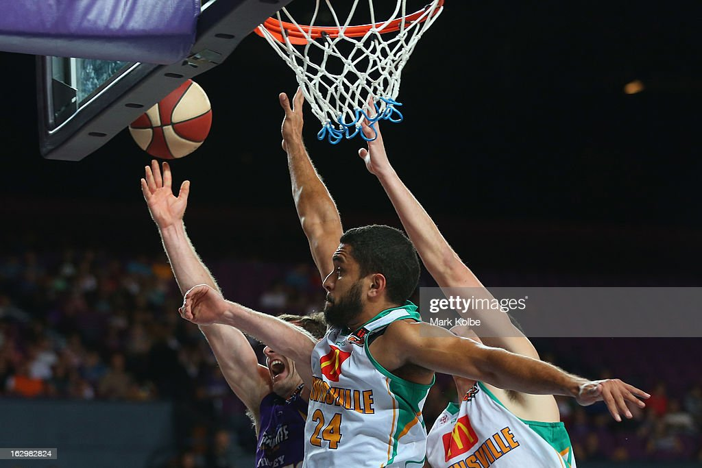Ben Madgen of the Kings is fouled as he shoots during the round 21 NBL match between the Sydney Kings and the Townsville Crocodiles at Sydney Entertainment Centre on March 3, 2013 in Sydney, Australia.