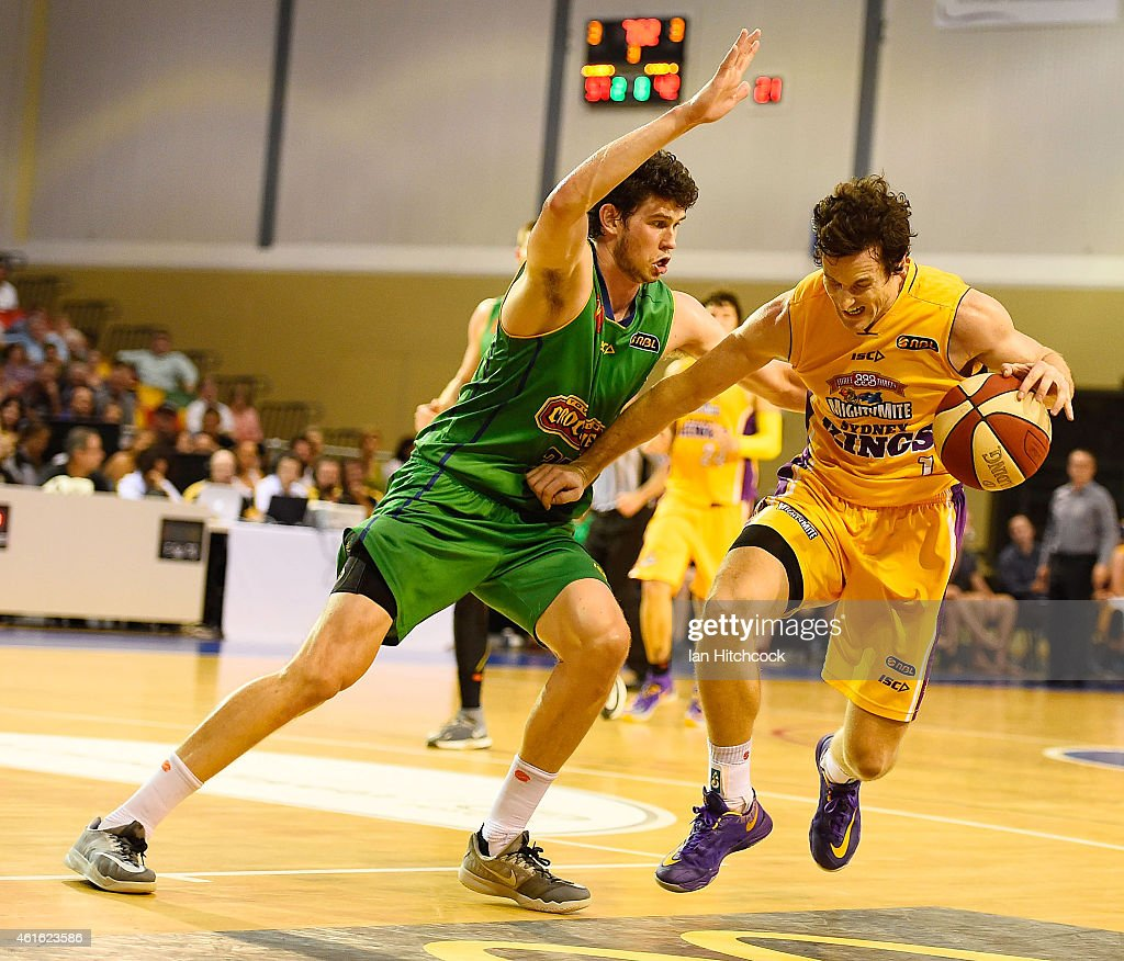 Ben Madgen of the Kings looks to get past Clint Steindl of the Crocodiles during the round 15 NBL match between the Townsville Crocodiles and Sydney Kings at Townsville RSL Stadium on January 16, 2015 in Townsville, Australia.