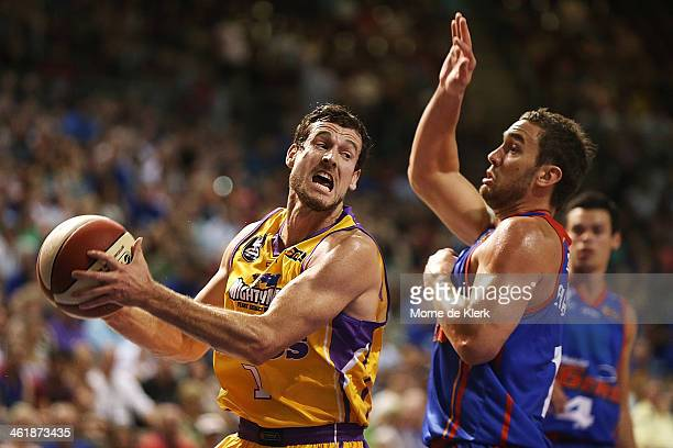 Ben Madgen of the Kings takes on Adam Gibson of the 36ers during the round 13 NBL match between the Adelaide 36ers and the Sydney Kings at Adelaide...