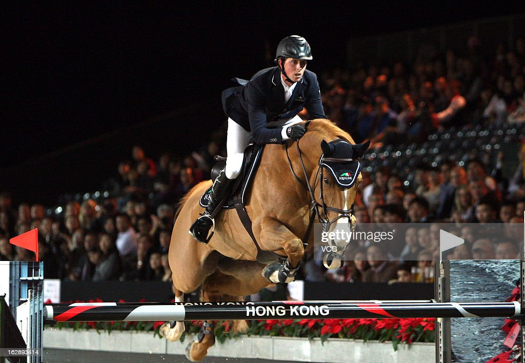 <a gi-track='captionPersonalityLinkClicked' href=/galleries/search?phrase=Ben+Maher+-+Equestrian&family=editorial&specificpeople=605147 ng-click='$event.stopPropagation()'>Ben Maher</a> of GBR rides Aristo Z at the Prix Artemide during the Longines Hong Kong Masters International Show Jumping at Asia World Expo on February 28, 2013 in Hong Kong, Hong Kong.