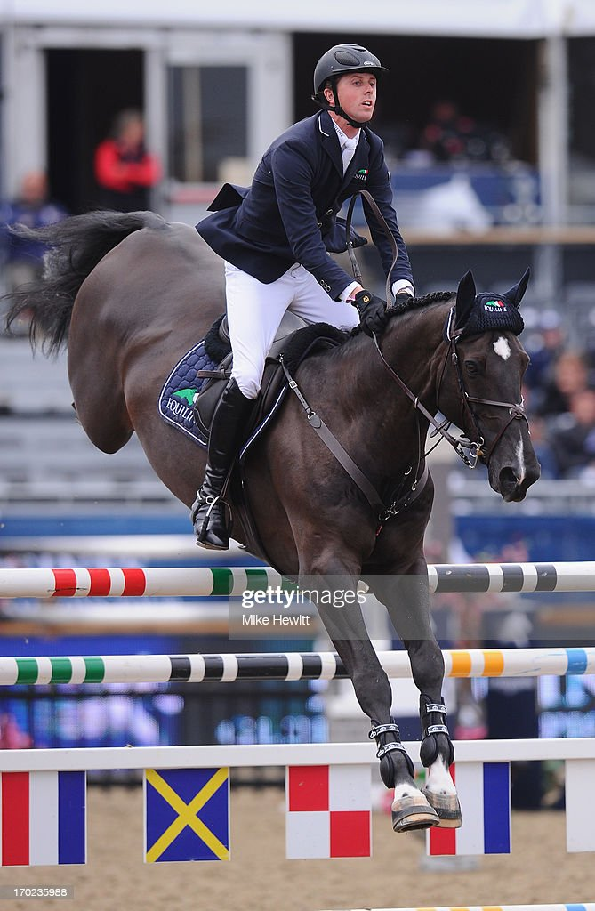 <a gi-track='captionPersonalityLinkClicked' href=/galleries/search?phrase=Ben+Maher+-+Equestrian&family=editorial&specificpeople=605147 ng-click='$event.stopPropagation()'>Ben Maher</a> of Great Britain on Triple X III on their way to 2nd place during the Longines Global Champions Tour of London on Day Four at Olympic Park on June 9, 2013 in London, England.