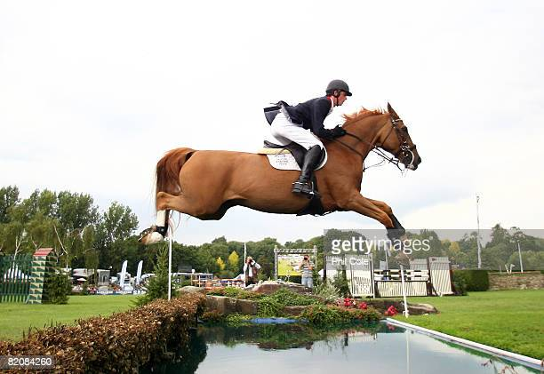 Ben Maher riding Alfredo II clears the Water Jump during the Old Lodge Queen Elizabeth II Cup on July 26 in Hickstead England