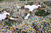 Ben Malena and Trey Williams of the Texas AM Aggies celebrate a 4113 win against the Oklahoma Sooners during the Cotton Bowl at Cowboys Stadium on...