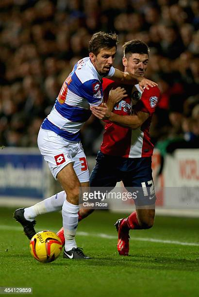 Ben Marshall of Blackburn Rovers is challenged by Gary O'Neil of Queens Park RAngers during the Sky Bet Championship match between Queens Park...