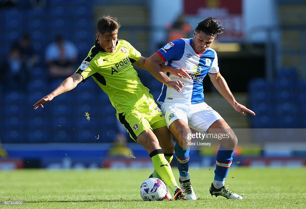 Ben Marshall of Blackburn Rovers is tackled by Jerry Yates of Rotherham United during the Sky Bet Championship match between Blackburn Rovers and Rotherham United at Ewood Park on September 17, 2016 in Blackburn, England.