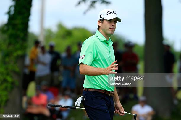 Ben Martin acknowledges the crowd on the tenth hole during the final round of the John Deere Classic at TPC Deere Run on August 14 2016 in Silvis...