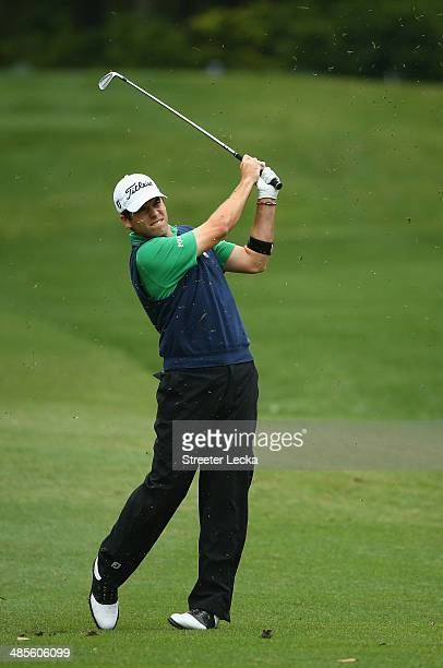 Ben Martin plays a shot on the 8th fairway during a continuation of the second round of the RBC Heritage at Harbour Town Golf Links on April 19 2014...
