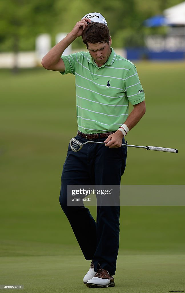 Ben Martin reacts after a double bogey on the 18th during Round Two of the Zurich Classic of New Orleans at TPC Louisiana on April 25 2014 in...
