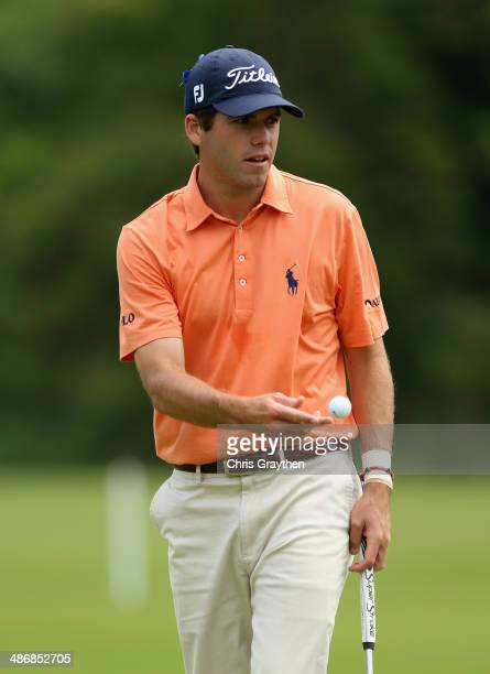 Ben Martin tosses his ball to his caddy after putting on the 1st during Round Three of the Zurich Classic of New Orleans at TPC Louisiana on April 26...