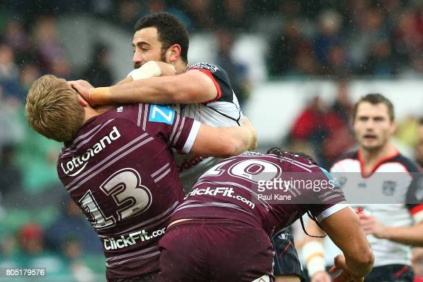 Ben Matulino of the Warriors attempts to fend off Jake Trbojevic of the Sea Eagles during the round 17 NRL match between the Manly Sea Eagles and the...