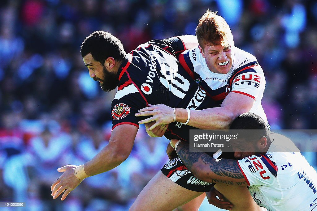 Ben Matulino of the Warriors charges forward during the round 24 NRL match between the New Zealand Warriors and the Sydney Roosters at Mt Smart Stadium on August 24, 2014 in Auckland, New Zealand.