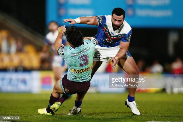 Ben Matulino of the Warriors floors James Roberts of the Broncos with a tackle during the round 12 NRL match between the New Zealand Warriors and the...