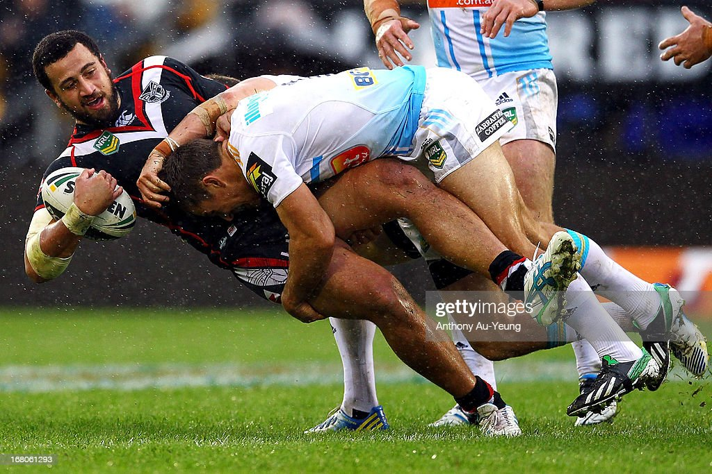 Ben Matulino of the Warriors is tackled by William Zillman of the Titans during the round eight NRL match between the New Zealand Warriors and the Gold Coast Titans at Mt Smart Stadium on May 5, 2013 in Auckland, New Zealand.