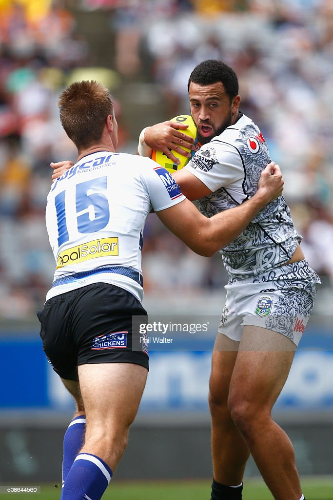 Ben Matulino of the Warriors is tackled during the match between the New Zealand Warriors and the Bulldogs during the 2016 NRL Auckland Nines at Eden Park on February 6, 2016 in Auckland, New Zealand.
