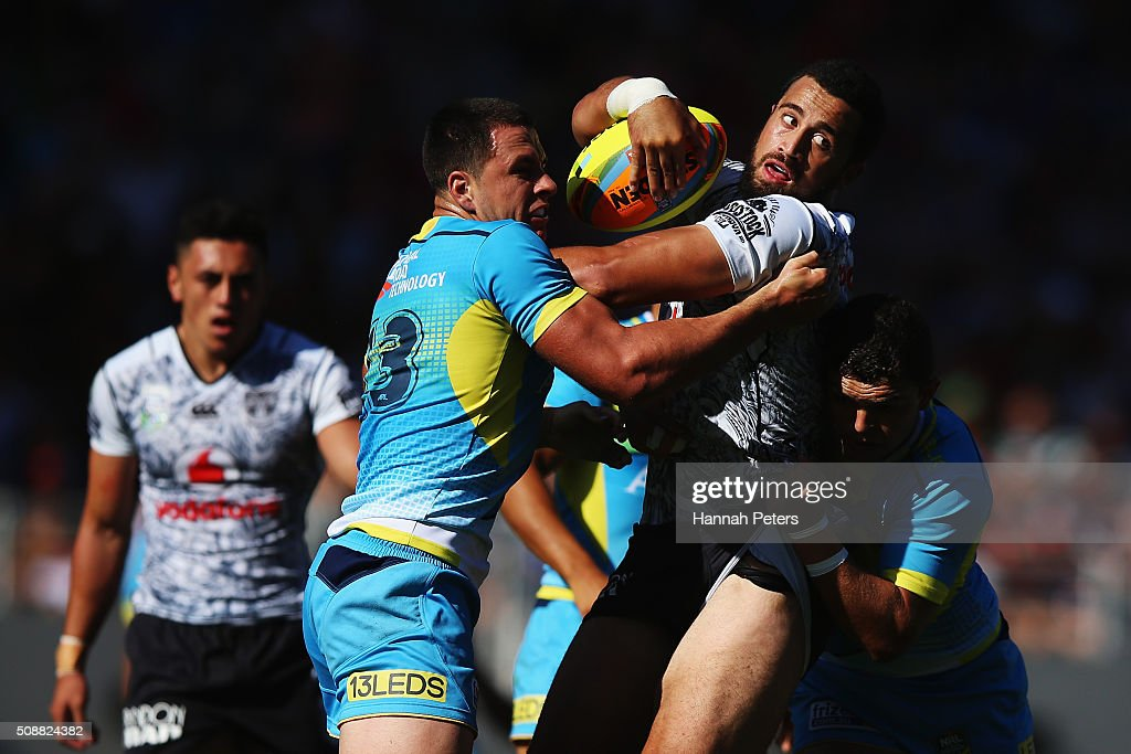 Ben Matulino of the Warriors offloads the ball during the 2016 Auckland Nines semi final match between the New Zealand Warriors and the Gold Coast Titans at Eden Park on February 7, 2016 in Auckland, New Zealand.