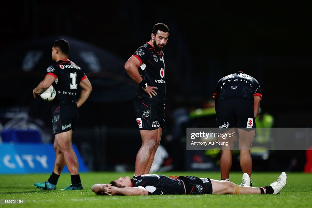 Ben Matulino, Roger Tuivasa-Sheck, Blake Ayshford and Sam Lisone of the Warriors look on after losing the round 25 NRL match between the New Zealand Warriors and the Manly Sea Eagles at Mt Smart Stadium on August 27, 2017 in Auckland, New Zealand.