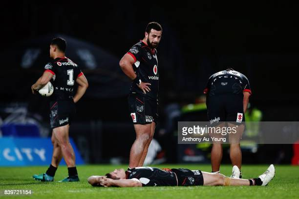 Ben Matulino Roger TuivasaSheck Blake Ayshford and Sam Lisone of the Warriors look on after losing the round 25 NRL match between the New Zealand...