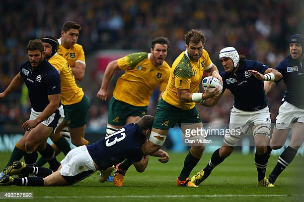 Ben McCalman of Australia is tackled by Mark Bennett of Scotland during the 2015 Rugby World Cup Quarter Final match between Australia and Scotland...