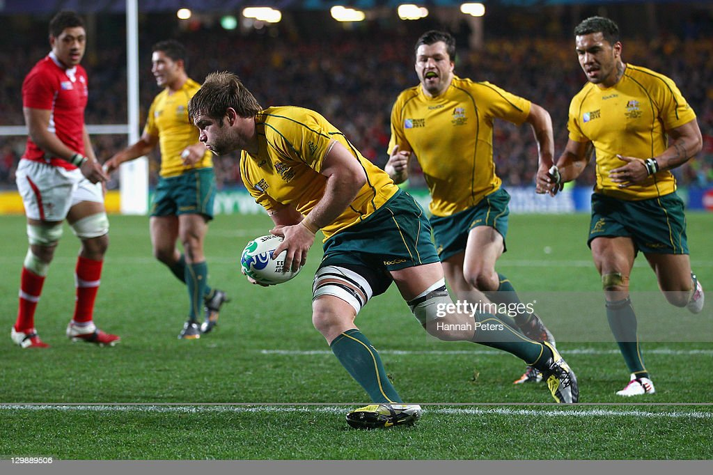 <a gi-track='captionPersonalityLinkClicked' href=/galleries/search?phrase=Ben+McCalman&family=editorial&specificpeople=5400341 ng-click='$event.stopPropagation()'>Ben McCalman</a> of the Wallabies goes over to score their second try during the 2011 IRB Rugby World Cup bronze final match between Wales and Australia at Eden Park on October 21, 2011 in Auckland, New Zealand.