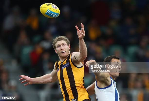 Ben McEvoy of the Hawks and Braydon Preuss of the Kangaroos compete for the ball during the round 21 AFL match between the Hawthorn Hawks and the...