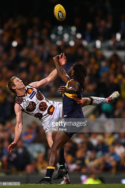 Ben McEvoy of the Hawks and Nic Naitanui of the Eagles contest the ruck during the round 22 AFL match between the West Coast Eagles and the Hawthorn...
