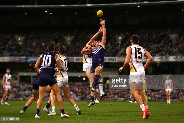 Ben McEvoy of the Hawks and Sean Darcy of the Dockers contest the ruck during the round 18 AFL match between the Fremantle Dockers and the Hawthorn...