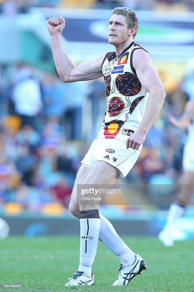 Ben McEvoy of the Hawks celebrates a goal during the round 10 AFL match between the Brisbane Lions and the Hawthorn Hawks at The Gabba on May 28, 2016 in Brisbane, Australia.
