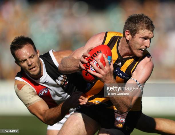 Ben McEvoy of the Hawks is challenged by Nathan Brown of the Saints during the round six AFL match between the Hawthorn Hawks and the St Kilda Saints...