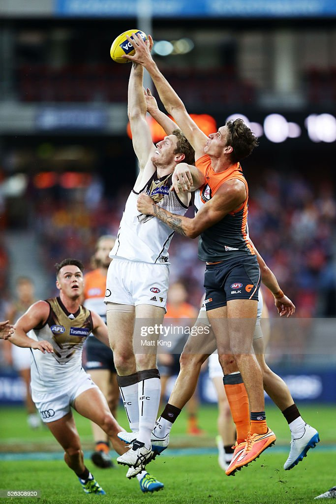 Ben McEvoy of the Hawks is challenged by Rory Lobb of the Giants during the round six AFL match between the Greater Western Sydney Giants and the Hawthorn Hawks at Spotless Stadium on April 30, 2016 in Sydney, Australia.