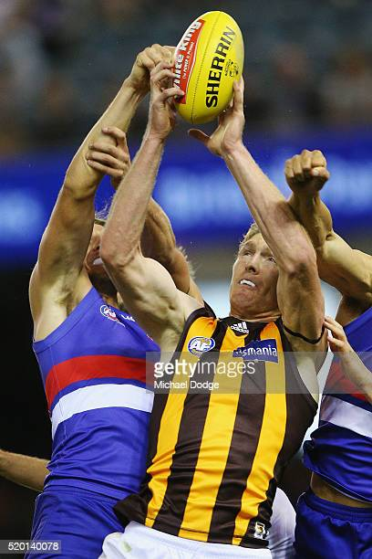 Ben McEvoy of the Hawks marks the ball against Jordan Roughead of the Bulldogs during the round three AFL match between the Western Bulldogs and the...