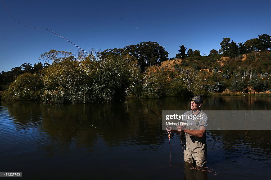 Ben McEvoy of the Hawks participates in fly fishing at Old Macs Farm and Fishery during the Hawthorn Hawks AFL Community Camp on February 22, 2014 in Launceston, Australia.